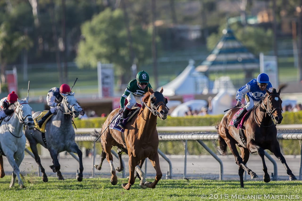 Ring Weekend (center), Summer Front (right) and Za Approval (far left) drive home in the G1 Frank E. Kilroe Mile S. at Santa Anita Park.