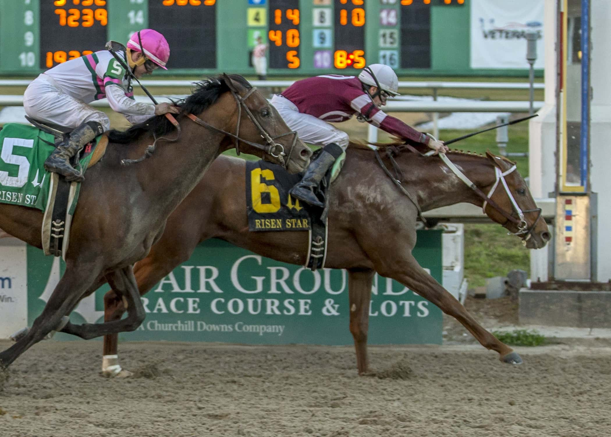 Gun Runner, No 6, with jockey Shaun Bridgmohan aboard, drives to the wire to win the Risen Star Stakes (GrII) at the Fair Grounds Race Course in New Orleans, LA Saturday, February 20, 2016. Photo By Lou Hodges, Jr. / Hodges Photography