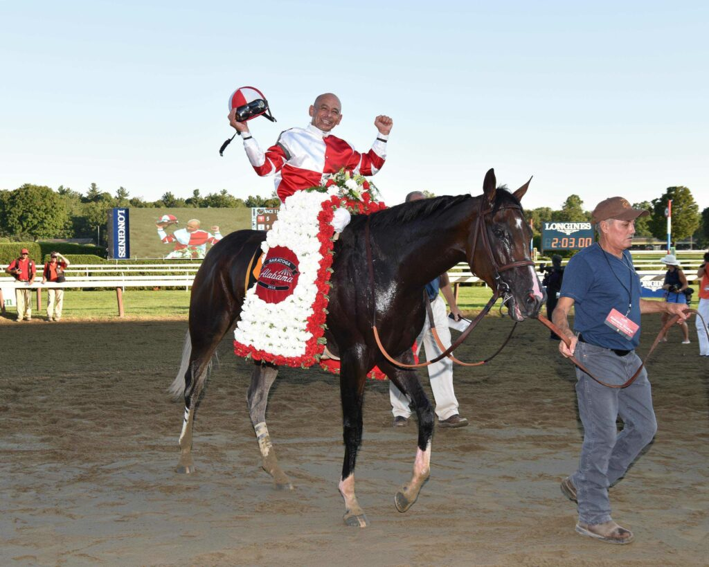 Mike Smith and Songbird celebrate winning the G1 Alabama at Saratoga (Photo Credit: NYRA)